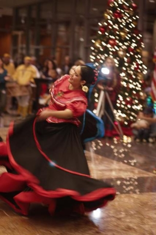 A Sol de Rancho dancer performs during the Christmas tree lighting ceremony held at the North Las Vegas City Hall in December 2011. This year's tree lighting event is scheduled at 5 p.m. Dec. 10 i ...