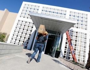 Julie Priest carries a box of books Saturday for the library at the new Gay & Lesbian Community Center of Southern Nevada at 401 S. Maryland Parkway. The soon-to-be-opened center is relocating fro ...
