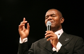 The Rev. Randall Cunningham delivers a sermon at Remnant Ministries in Henderson. The former UNLV and NFL quarterback has been named the head football coach at Silverado High.