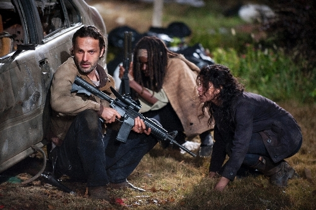 "Andrew Lincoln as Rick Grimes, Danai Gurira as Michonne and Melissa Ponzio as Karen, in a scene from Episode 16, ""Welcome to the Tombs"" from Season 3 of The Walking Dead. (Courtesy, AMC)"