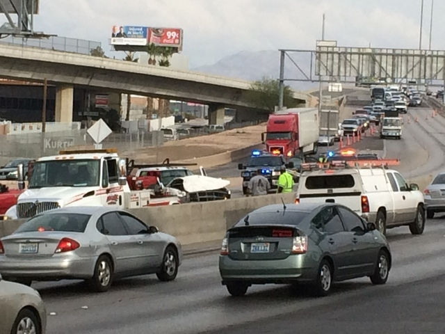 A three-vehicle crash is blocking all northbound lanes of U.S. Highway 95 at the Spaghetti Bowl, Friday, Dec. 5, 2014. (Bizu Tesfaye/Las Vegas Review-Journal)