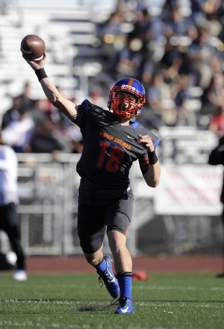 Bishop Gorman quarterback Tate Martell (18) passes  in the first half of their Division I state football semifinal game against Liberty at Rancho High School in Las Vegas Saturday, Nov. 29, 2014.  ...