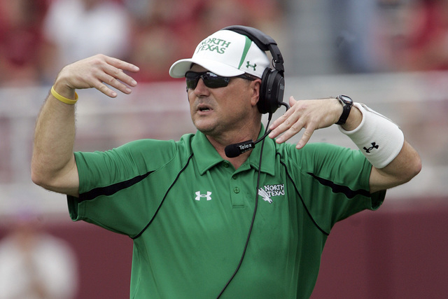 North Texas coach Todd Dodge yells instructions to his team during their NCAA college football game against Alabama at Bryant-Denny Stadium in Tuscaloosa, Ala., Saturday, Sept. 19, 2009. (AP Photo ...
