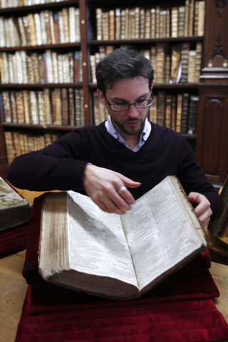 Remy Cordonnier, the director of the Saint-Omer librarys medieval and early modern collection, opens a page of the newly discovered Shakespeare's original first folio in Saint-Omer, northern Franc ...