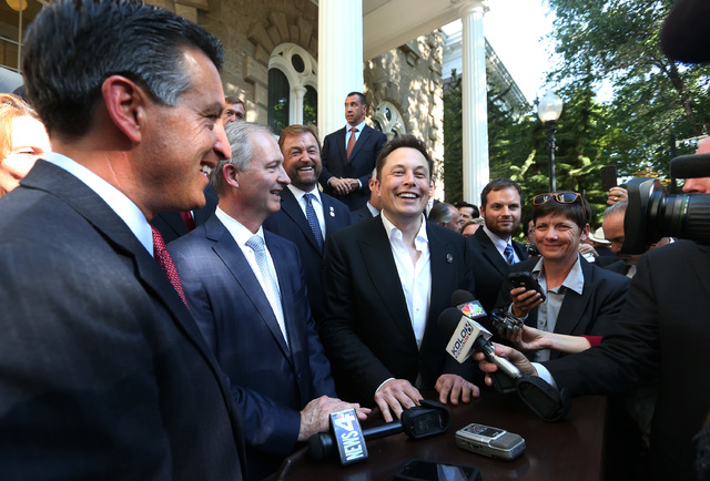 From left, Nevada Gov. Brian Sandoval, Steve Hill, executive director of the Governor's office of economic development, and Telsa Motors CEO Elon Musk answer questions following a news conference  ...