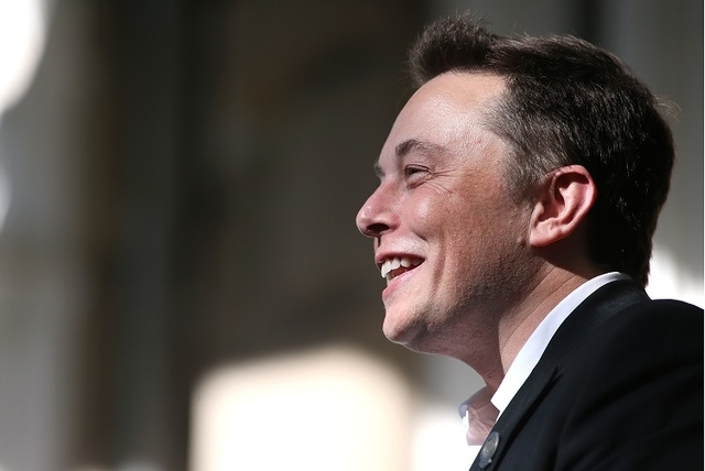 Tesla Motors CEO Elon Musk speaks at a press conference at the Capitol in Carson City, Nev., on Thursday, Sept. 4, 2014. (AP Photo/Cathleen Allison)