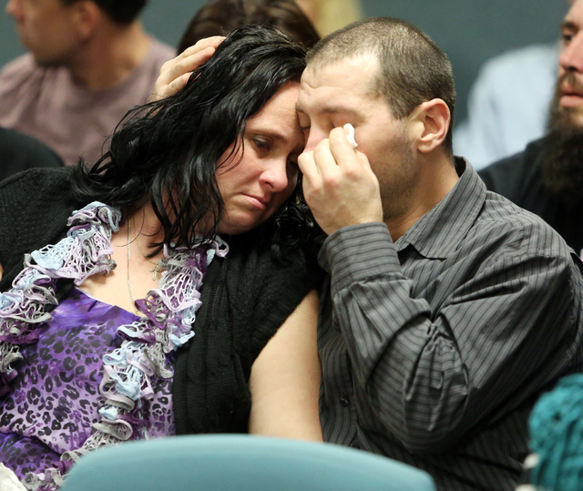 Family members of Nioami Lazicki-Gaston console each other during the sentencing of Joshua Malmgren, Friday, Dec. 5, 2014, in Cape May, N.J. Malmgren, guilty in the 2012 drunk-driving crash that k ...
