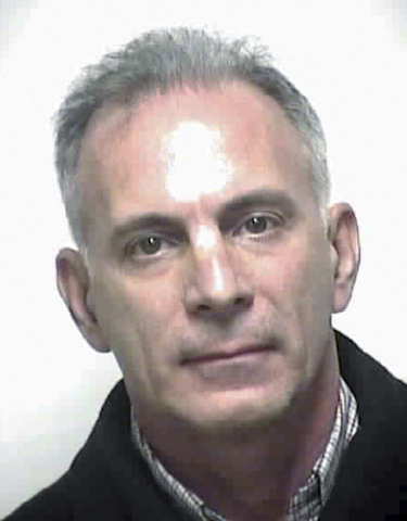 This booking photo provided by the Dedham, Massachusetts, Police Department shows Douglas Conigliaro, owner and president of Medical Sales Management, who was arrested at his home in Dedham, on We ...