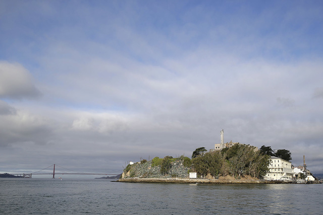 Alcatraz Island is shown with the Golden Gate Bridge in the background Wednesday, Sept. 24, 2014, in San Francisco. (AP Photo/Eric Risberg)