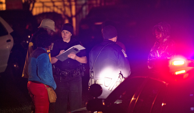 Auburn Police investigate a shooting at the Tiger Lodge apartments in Auburn, Ala., early Sunday morning, Dec. 14, 2014. Jakell Mitchell, 18, a current Auburn University football player, was trans ...