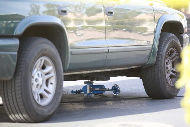 Las Vegas police investigate the scene of an accident involving a vehicle and small child at 8501 University Ave. in Las Vegas on Tuesday, Dec. 9, 2014. (Chase Stevens/Las Vegas Review-Journal)
