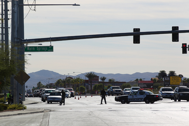 Las Vegas police investigate the scene where a vehicle hit and killed a 63-year-old man and injured an 18-month-old baby on Northbound Rainbow Boulevard near Warm Springs Road in Las Vegas on Mond ...