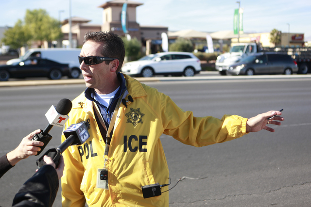 Detective Richard Tusko speaks with news media as Las Vegas police investigate the scene where a vehicle hit and killed a 63-year-old man and injured an 18-month-old baby on Northbound Rainbow Bou ...