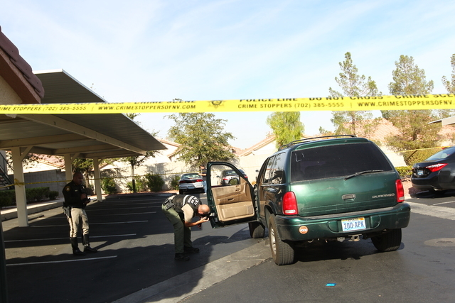 A child is in critical condition after being struck by a vehicle at an apartment complex at 8501 University Ave., Tuesday morning, Dec. 9, 2014, according to Las Vegas police. (Chase Stevens/Las V ...