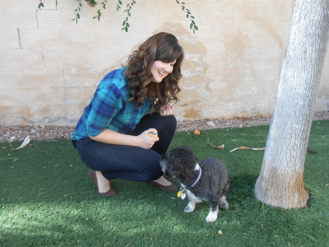 Kat Doyle plays with her dog Maggie Oct. 29, 2014, in the backyard of her northwest Las Vegas home. Doyle has a genetic heart condition and got a pacemaker at 17. Now 27, she's learned to live l ...