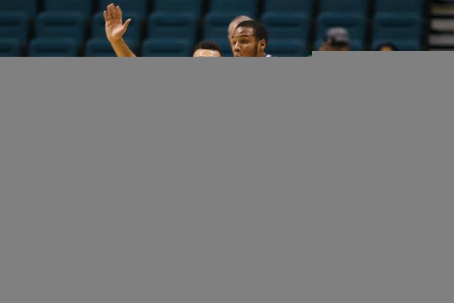 Washington guard Nigel Williams-Goss defends Oklahoma guard Jordan Woodard during their MGM Grand Showcase game Saturday, Dec. 20, 2014. (Sam Morris/Las Vegas Review-Journal)