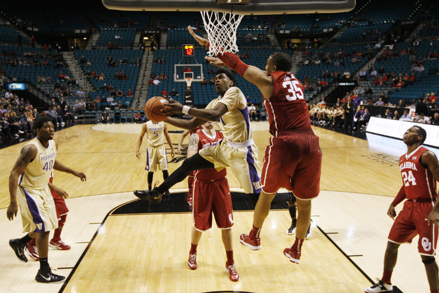 Washington guard Mike Anderson is defended by Oklahoma forward TaShawn Thomas as he drives to the basket during their MGM Grand Showcase game Saturday, Dec. 20, 2014. (Sam Morris/Las Vegas Review- ...