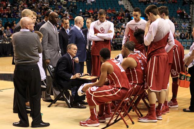 Oklahoma head coach Lon Kruger talks to his team during a time out in their MGM Grand Showcase game against Washington Saturday, Dec. 20, 2014. (Sam Morris/Las Vegas Review-Journal)