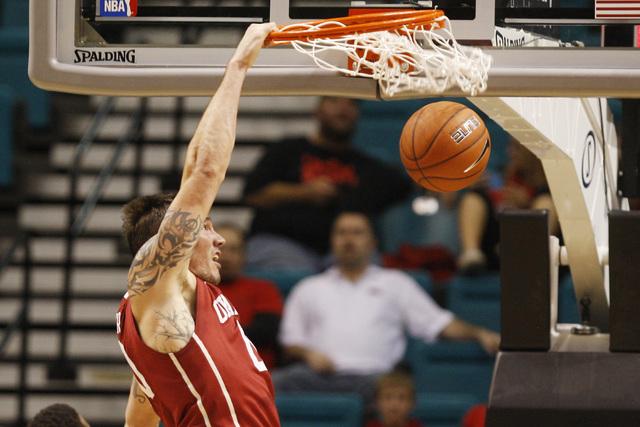 Oklahoma forward Ryan Spangler dunks on Washington during their MGM Grand Showcase game Saturday, Dec. 20, 2014. (Sam Morris/Las Vegas Review-Journal)