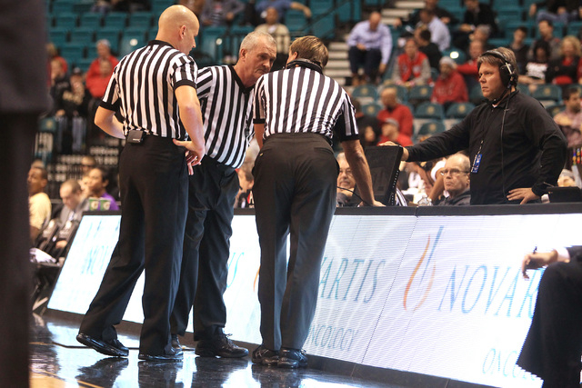 Referees review a play during the MGM Grand Showcase game between Washington and Oklahoma Saturday, Dec. 20, 2014. (Sam Morris/Las Vegas Review-Journal)