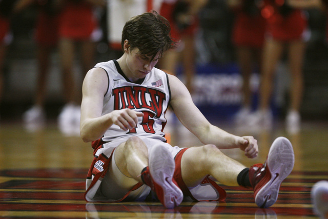 UNLV guard Cody Doolin hits the floor after falling down during their game against Arizona Tuesday, Dec. 23, 2014 at the Thomas & Mack Center. (Sam Morris/Las Vegas Review-Journal)