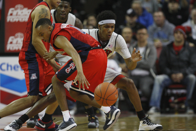 UNLV guard Patrick McCaw strips the ball from Arizona guard Parker Jackson-Cartwright during their game Tuesday, Dec. 23, 2014 at the Thomas & Mack Center. (Sam Morris/Las Vegas Review-Journal)