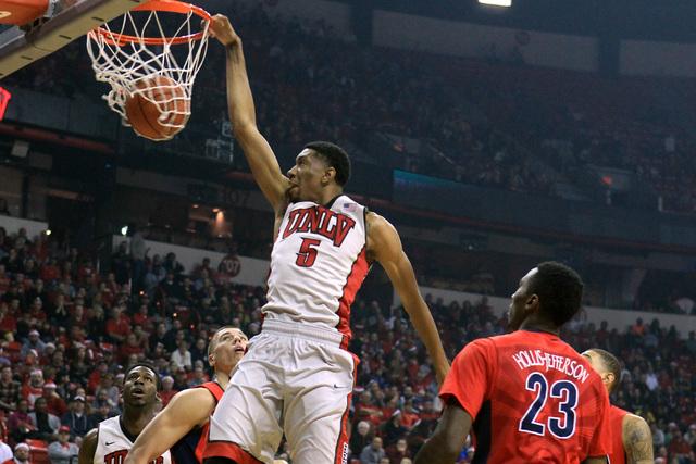 UNLV forward Christian Wood dunks on Arizona during their game Tuesday, Dec. 23, 2014 at the Thomas & Mack Center. (Sam Morris/Las Vegas Review-Journal)