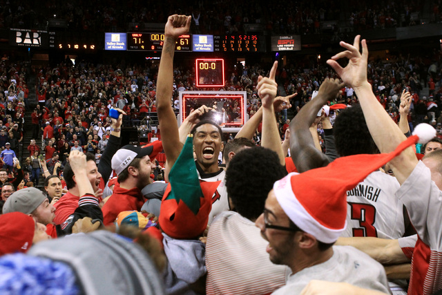 UNLV forward Christian Wood celebrates as fans storm the court after the Rebels upset of third ranked Arizona 71-67 Tuesday, Dec. 23, 2014 at the Thomas & Mack Center. (Sam Morris/Las Vegas Review ...