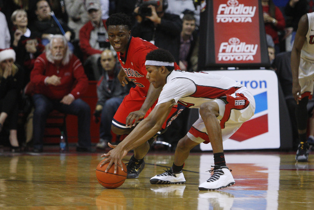UNLV guard Patrick McCaw picks up a loose ball after Arizona forward Stanley Johnson lost the ball as time runs out in their game Tuesday, Dec. 23, 2014 at the Thomas & Mack Center. UNLV upset thi ...
