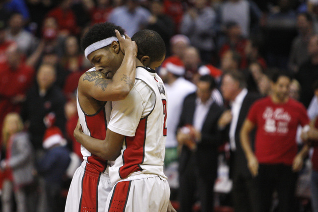 UNLV guard Jelan Kendrick, left, and UNLV guard Patrick McCaw embrace in the final second of their 71-67 upset of third ranked Arizona Tuesday, Dec. 23, 2014 at the Thomas & Mack Center. (Sam Morr ...