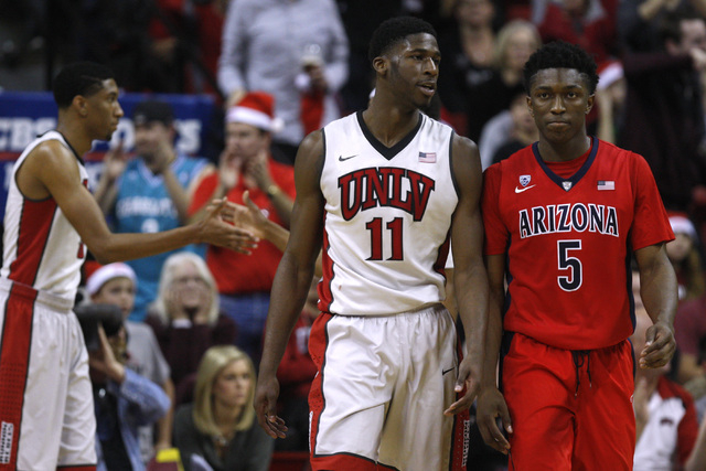 UNLV forward Goodluck Okonoboh has words with Arizona forward Stanley Johnson after he blocked Johnson's shot during their game Tuesday, Dec. 23, 2014 at the Thomas & Mack Center. UNLV upset third ...