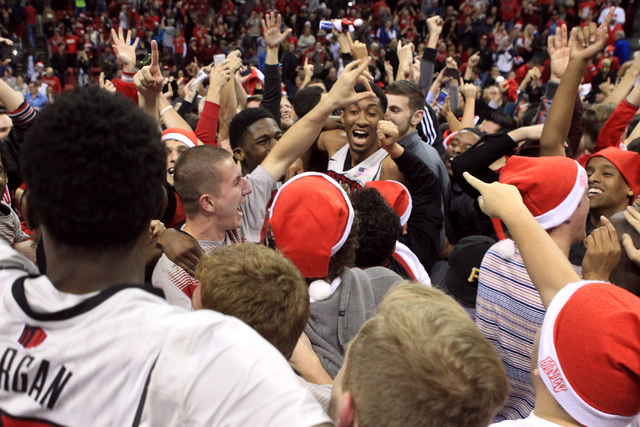 Fans and players celebrate UNLV's 71-67 upset of third ranked Arizona 71-67 Tuesday, Dec. 23, 2014 at the Thomas & Mack Center. (Sam Morris/Las Vegas Review-Journal)