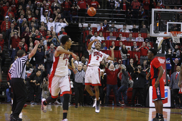 UNLV guard Patrick McCaw tosses the ball with less than a second to go in their 71-67 upset of Arizona Tuesday, Dec. 23, 2014 at the Thomas & Mack Center. (Sam Morris/Las Vegas Review-Journal)