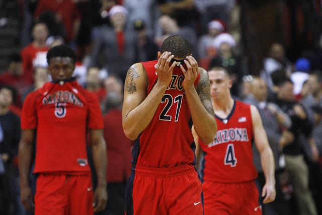 Arizona forward Brandon Ashley covers his face in the final second of their loss to UNLV Tuesday, Dec. 23, 2014 at the Thomas & Mack Center. (Sam Morris/Las Vegas Review-Journal)
