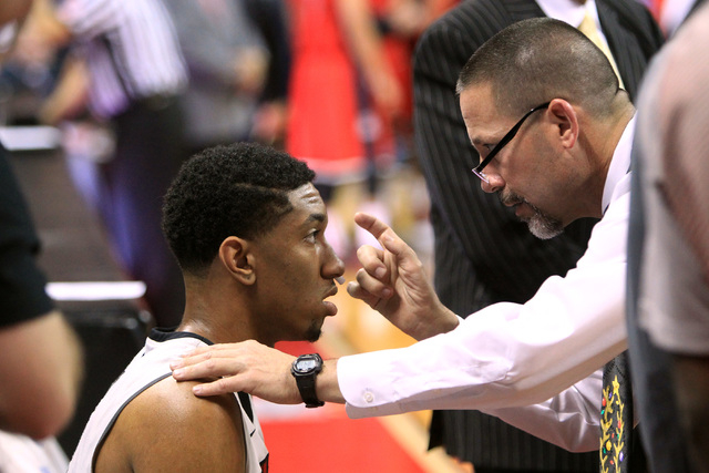 Trainer Dave Tomcheck checks on UNLV forward Christian Wood after he took a hit during their game against Arizona Tuesday, Dec. 23, 2014 at the Thomas & Mack Center. (Sam Morris/Las Vegas Review-J ...