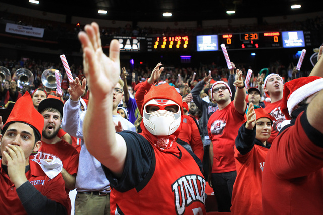 UNLV students chant before their game against Arizona Tuesday, Dec. 23, 2014 at the Thomas & Mack Center. (Sam Morris/Las Vegas Review-Journal)
