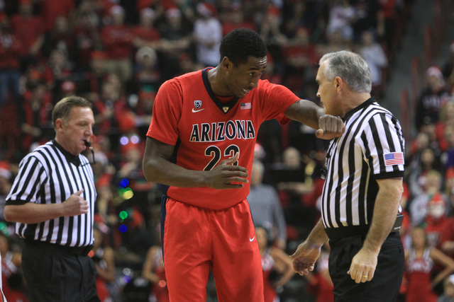 Arizona forward Rondae Hollis-Jefferson complains to referee Randy McCall during their game Tuesday, Dec. 23, 2014 at the Thomas & Mack Center. Hollis-Jefferson eventually fouled out in UNLV's 71- ...
