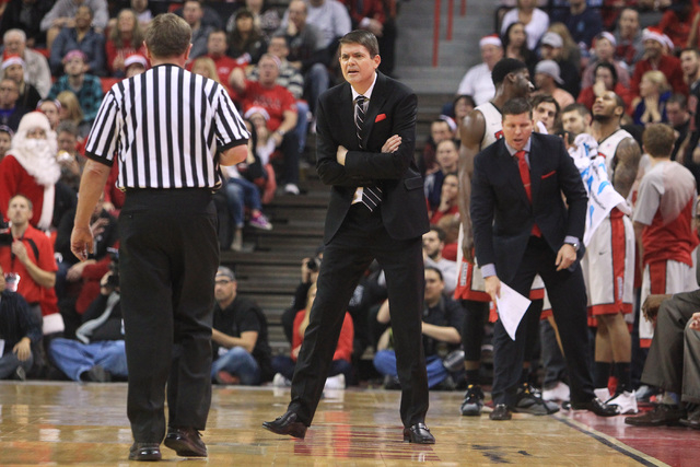 UNLV head coach Dave Rice questions the call of official David Hall during their game Tuesday, Dec. 23, 2014 at the Thomas & Mack Center. (Sam Morris/Las Vegas Review-Journal)