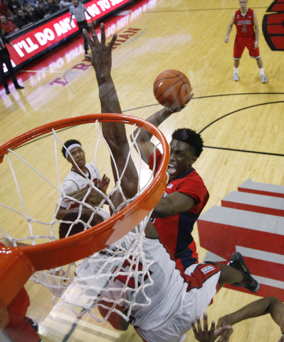 Arizona forward Stanley Johnson drives to the basket against UNLV during their game Tuesday, Dec. 23, 2014 at the Thomas & Mack Center. (Sam Morris/Las Vegas Review-Journal)