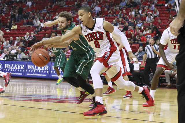 UNLV  guard Kendall Smith grabs a loose ball from Florida National University guard Regan O'Rourke during their exhibition game Wednesday, Nov. 5, 2014 at the Thomas & Mack Center in Las Vegas. (S ...