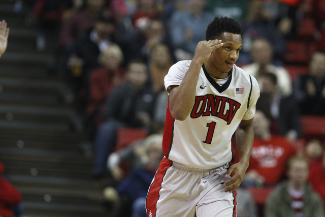 UNLV guard Rashad Vaughn salutes after draining a 3-point shot during the first half of their game against Portland Wednesday, Dec. 17, 2014 at the Thomas & Mack Center. (Sam Morris/Las Vegas Revi ...