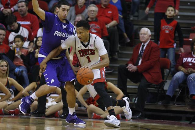 UNLV guard Rashad Vaughn drives around Portland guard Bryce Pressley during the first half of their game Wednesday, Dec. 17, 2014 at the Thomas & Mack Center. (Sam Morris/Las Vegas Review-Journal)