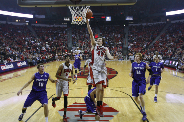 UNLV guard Cody Doolin drives to the basket against Portland during the first half of their game Wednesday, Dec. 17, 2014 at the Thomas & Mack Center. (Sam Morris/Las Vegas Review-Journal)