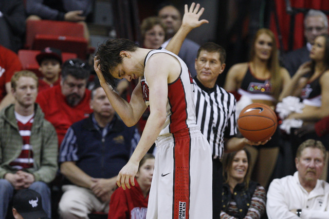 UNLV guard Cody Doolin scratches his head after committing an offensive miscue during the first half of their game against Portland Wednesday, Dec. 17, 2014, at the Thomas & Mack Center. (Sam Morr ...