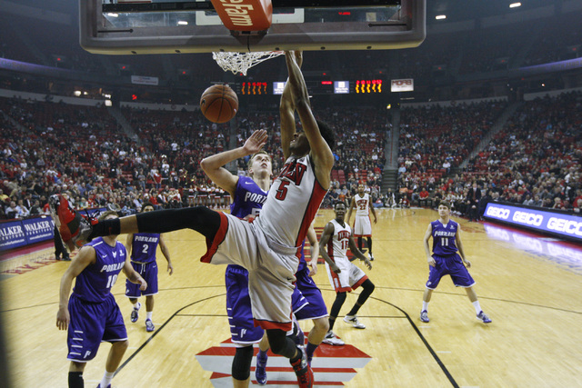 UNLV forward Christian Wood dunks on Portland during the first half of their game Wednesday, Dec. 17, 2014 at the Thomas & Mack Center. (Sam Morris/Las Vegas Review-Journal)