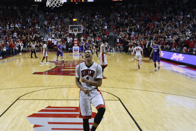 UNLV guard Rashad Vaughn celebrates UNLV guard Cody Doolin's basket at the buzzer during overtime of their game Wednesday, Dec. 17, 2014 at the Thomas & Mack Center. UNLV won 75-73 in overtime. (S ...