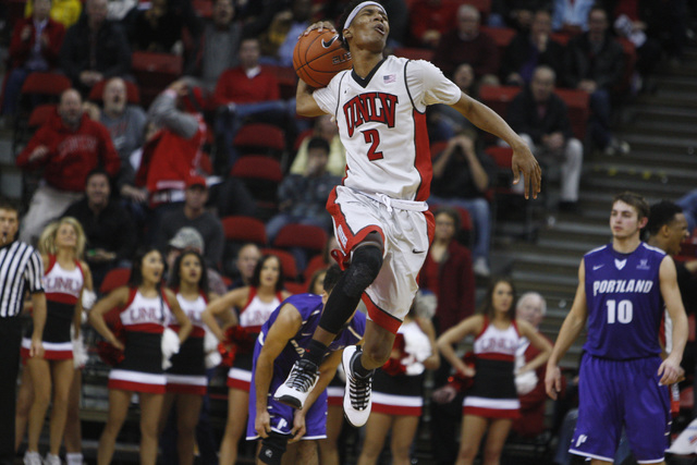 UNLV guard Patrick McCaw reacts after being called for a foul during the second half of their game against Portland Wednesday, Dec. 17, 2014 at the Thomas & Mack Center. UNLV won 75-73 in overtime ...
