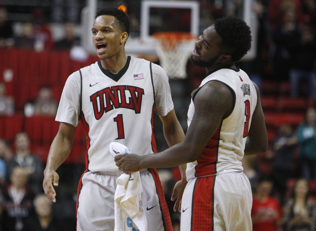 UNLV guard Rashad Vaughn, left, and UNLV guard Jordan Cornish react after pulling ahead of Portland during overtime of their game Wednesday, Dec. 17, 2014 at the Thomas & Mack Center. UNLV won 75- ...