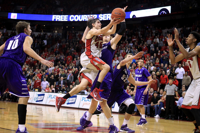 UNLV guard Cody Doolin drives to the basket with the winning shot against Portland during overtime of their game Wednesday, Dec. 17, 2014 at the Thomas & Mack Center. UNLV won 75-73 in overtime. ( ...