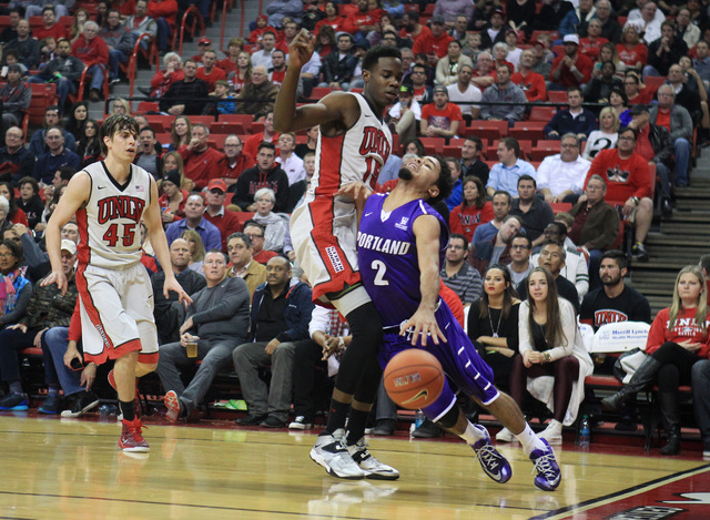 Portland guard Alex Wintering draws a foul from UNLV forward Dwayne Morgan  during the first half of their game Wednesday, Dec. 17, 2014 at the Thomas & Mack Center. (Sam Morris/Las Vegas Review-J ...